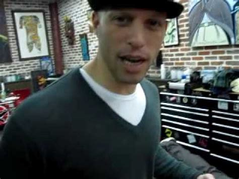 ami james now chris nunez tattooing a dragon in miami beach tattoo shop