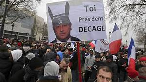Day of Anger: Thousands rally in Paris to protest Hollande ...