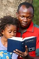 Father and daughter reading the Bible, Lome, Togo, West ...