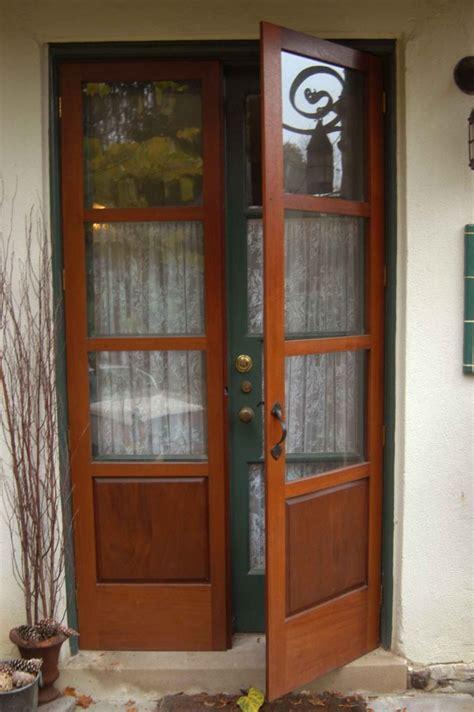 furniture brown wooden door with half glass decoration
