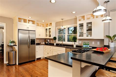 recessed lighting kitchen remodel stove in peninsula kitchen traditional with wood floors