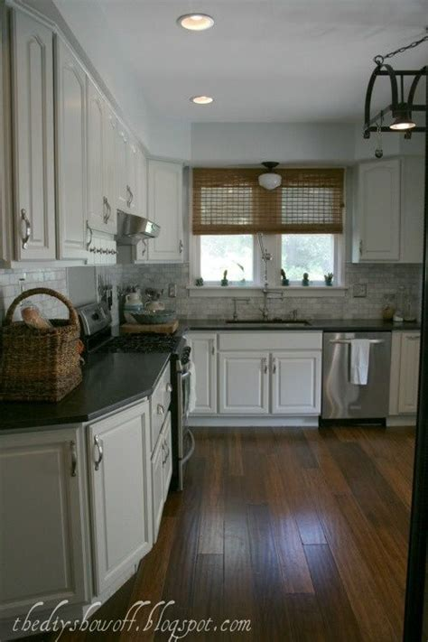 white cabinets benjamin moore moonshine marble tile