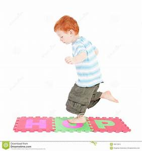Boy hopping over word stock photo. Image of letters, smile ...