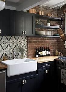 black farmhouse kitchen with brick backsplash