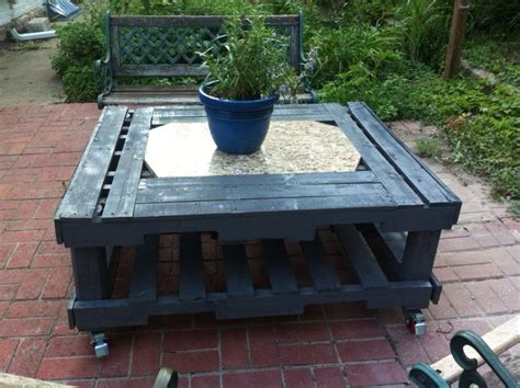 back patio table made with 3 used pallets and scrap