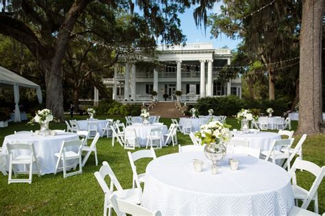 reception décor photos outdoor dinner tables with white chairs inside weddings