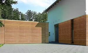Garagentor Aus Holz : neue h rmann garagentore u a fassadenb ndig h rmann garagentor holzverkleidung und garage ~ Watch28wear.com Haus und Dekorationen