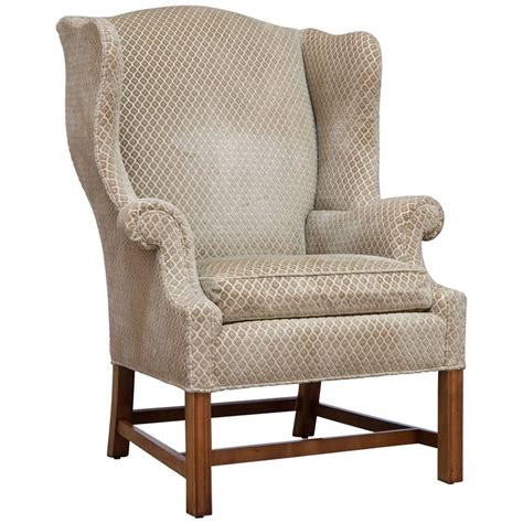 chippendale style mahogany framed wing chair by baker for