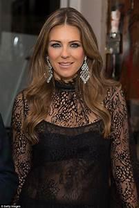 Elizabeth Hurley flashes her toned torso at Royals ...