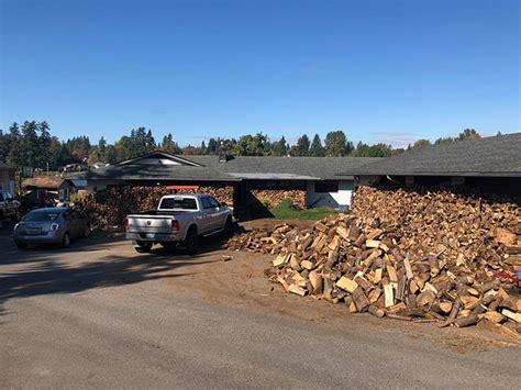 father    sons cut wood  fill  trucks