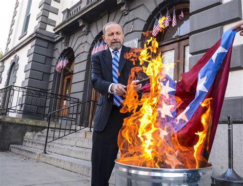 activist ignites discussion  burning nazi confederate