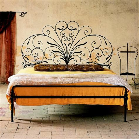wrought iron beds for a wonderful mediterranean flair in