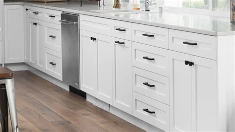 Décor details choosing the right cabinet hardware. White Shaker Cabinets | Lakehouse Remodel | HighCraft Cabinets
