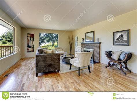 Living Room With Hardwood Floor Fireplace And Large