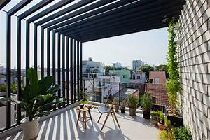 Narrow Townhouse In Vietnam By MM Architects