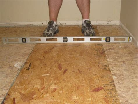 how to fix uneven floors level an uneven crowning subfloor by planing sanding joists one project closer