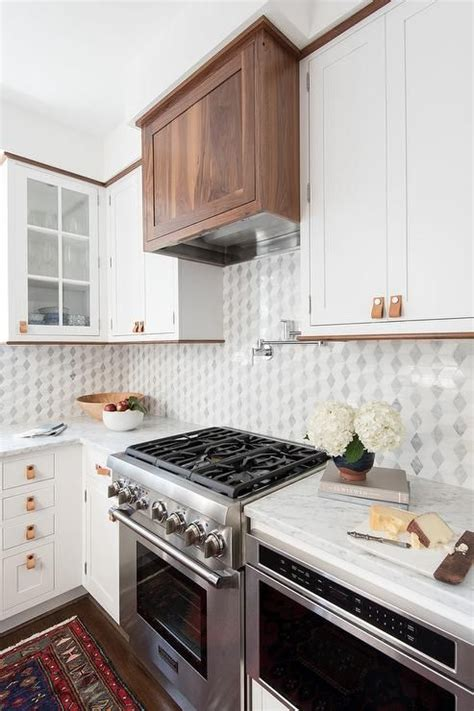 how to put backsplash in the kitchen 1000 ideas about above range microwave on 9532