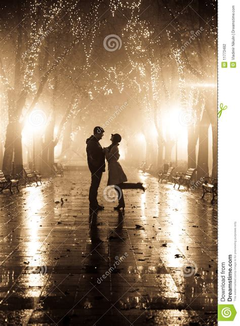 couple walking  alley  night lights stock photography