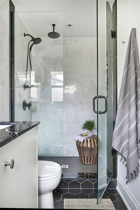 black hex shower floor tiles  gray marble herringbone