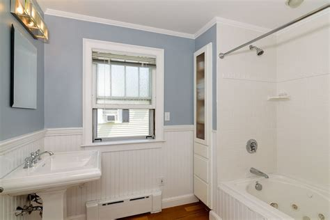 bathroom crown molding ideas cottage full bathroom with wainscoting hardwood floors
