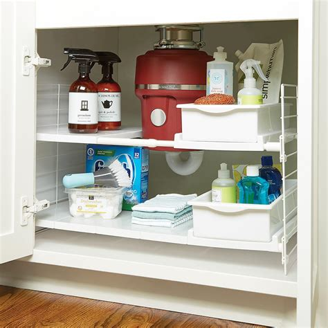 under cabinet storage containers iris expandable under sink organizer the container store