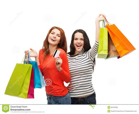 Teenage Girls With Shopping Bags And Credit Card Stock