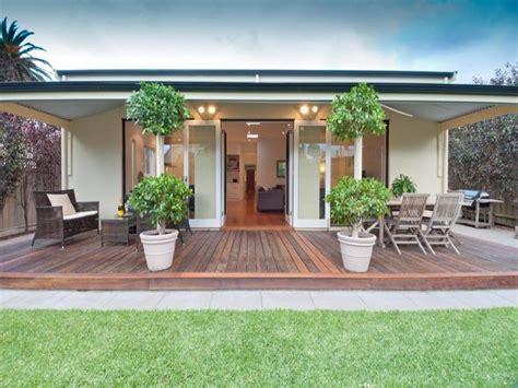 patio area ideas multi level outdoor living design with bbq area decorative lighting using grass outdoor