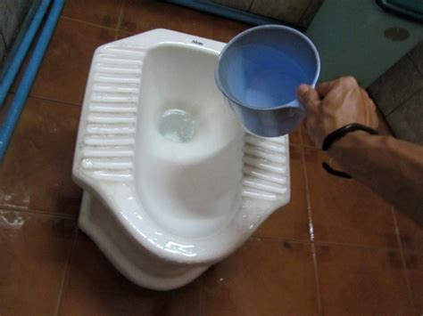 Eastern Water Closet by How To Use A Squat Toilet Like A Pro