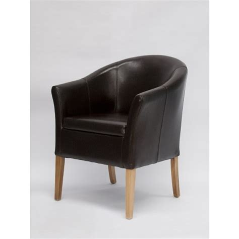 brown leather tub dining chair with solid oak legs oak
