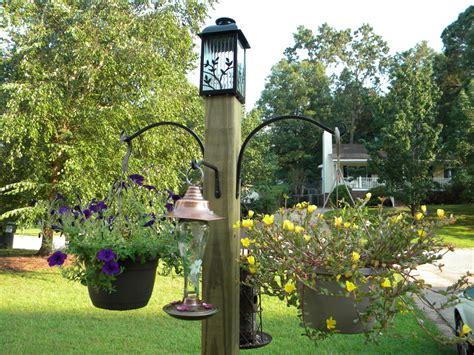 diy freestanding bird feeder and flower post we call it