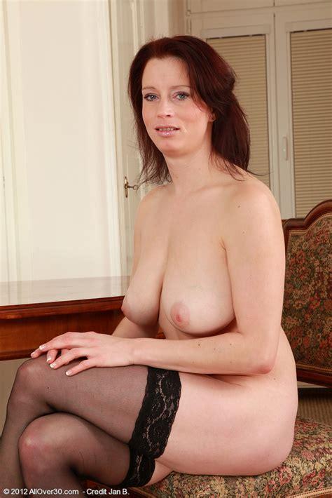 classy redhead milf carol polish her pearl busty vixen