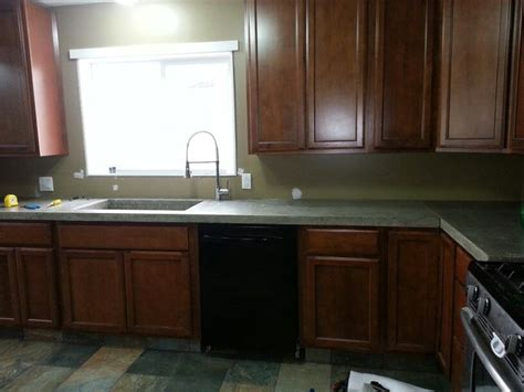 which side is water on a sink my kitchen maple cabinets concrete countertops side