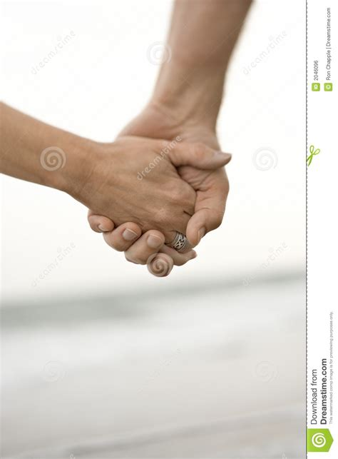 Couple holding hands stock photo. Image of image, shore