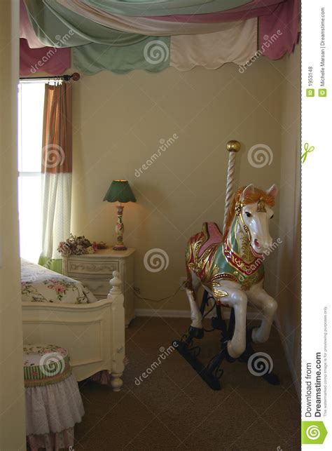 young girls bedroom  carousel horse stock photo
