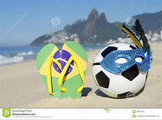 Carnival Mask Soccer Ball Football And Flip Flops On Beach