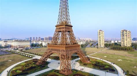 eiffel tower replicas   world  jour de