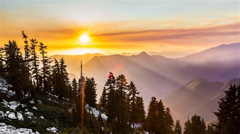Sunrise over snowy mountains free image