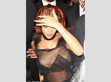 Rihanna suffers a double nipslip as she goes braless and