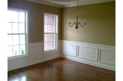formal dining room tanyellow walls white moulding trim