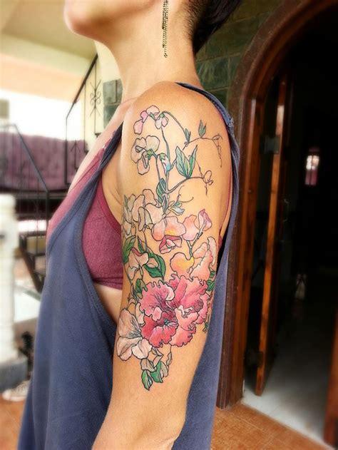 pink flowers arm  tattoo design ideas