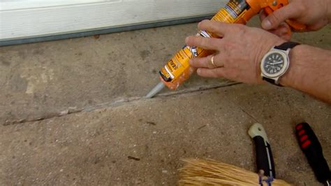 how to caulk and seal cracks in a concrete driveway
