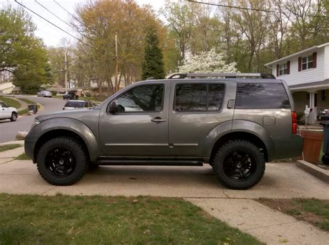 lifted silver nissan frontier nissan pathfinder lift 285 75 16 duratracs photos