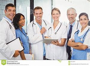 Portrait Of Medical Team Standing With Digital Tablet And ...