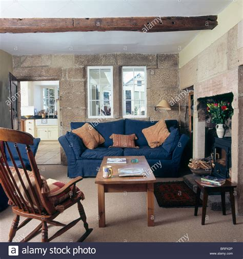 bloombety blue living room cottage windsor chair and wooden coffee table in cottage living room with stock photo royalty free