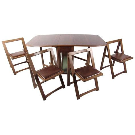 dining table with rolling chairs mid century modern rolling drop leaf table with chairs for