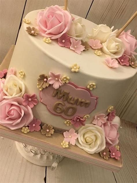 In the 17th century, birthday cakes became more adorable since it includes icing, layers and decorated with flowers. 60th Birthday Cake - cake by Shereen - CakesDecor