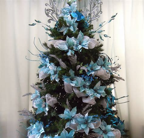 blue and silver christmas tree and blue picks no ornaments yet and it looks full already i
