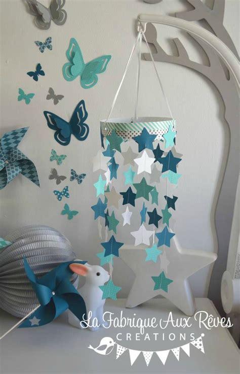 chambre bébé bleu turquoise mobile étoiles bébé garçon turquoise caraïbe pétrole blanc