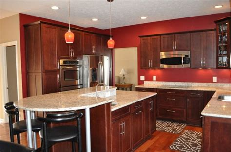 cherry cabinets with gray countertops cherry kitchen cabinets with gray wall and quartz