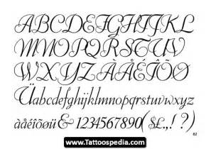 cursive writing tatto